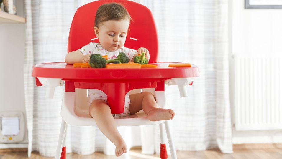 Kinderhochstuhl mit Baby