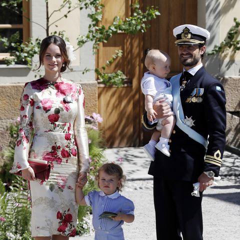 Princess Sofia of Sweden,Prince Alexander of Sweden and Prince Carl Phillip of Sweden holding Prince Gabriel of Sweden
