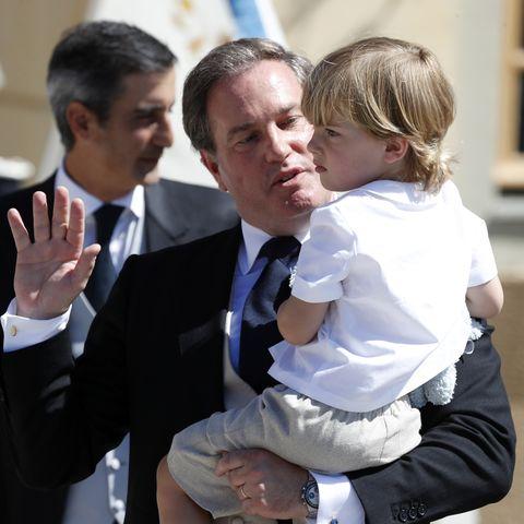 Christopher O'neill holding Prince Nicolas of Sweden