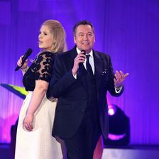Roland Kaiser (R) and Maite Kelly perform during the 'Die Besten im Fruehling' TV show at GETEC Arena on March 14, 2015 in Magdeburg, Germany.