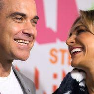 Für Freunde und Kollegen war der Familienzuwachs bei Robbie Williams und seiner Frau Ayda eine Überraschung.