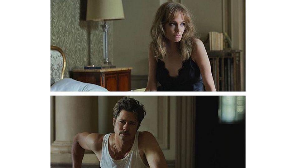 Angelina Jolie in einem schwarzen Kleid. Brad Pitt in einem weißen Unterhemd.
