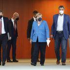 Michael Müller, Angela Merkel und Markus Söder (von links).
