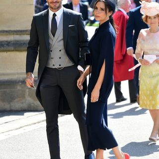 David Beckham (L)  and fashion designer Victoria Beckham (R) arrive for the wedding ceremony of Britain's Prince Harry, Duke of Sussex and US actress Meghan Markle at St George's Chapel, Windsor Castle, in Windsor, on May 19, 2018