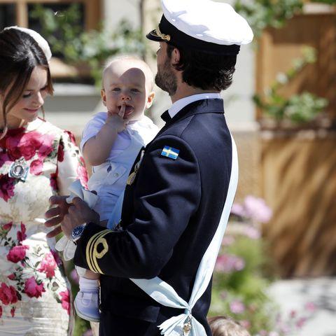Princess Sofia of Sweden and Prince Carl Phillip of Sweden holding Prince Gabriel of Sweden