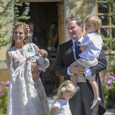 Princess Madeleine of Sweden, holding Princess Adrienne of Sweden, Princess Eleonore of Sweden and Christopher O'neil holding Prince Nicolas of Sweden